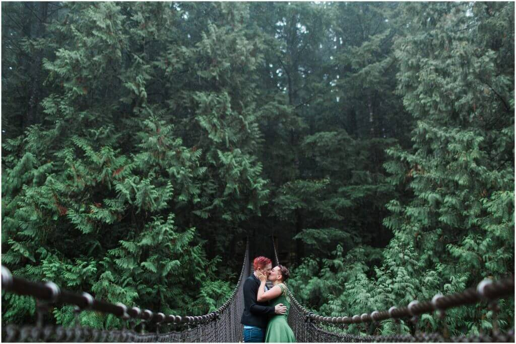 Engagement session of a same sex couple at Lynn Valley suspension bridge in North Vancouver