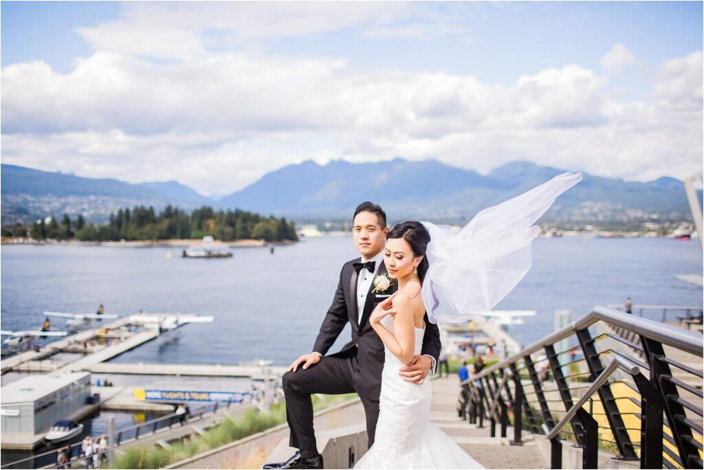 Vancouver wedding photographer, David Tam, photographs a couple's ballroom wedding at the Pinnacle Harbour Front Hotel in downtown Vancouver.  Bridal and wedding party portraits where taken in the downtown and coal harbour areas.