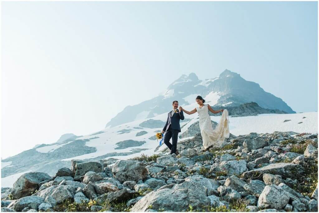 Beautiful outdoor wedding of an adventurous couple on top of the Tantalus mountain range in Squamish, BC.  Transportation provided by Black Tusk Helicopters.