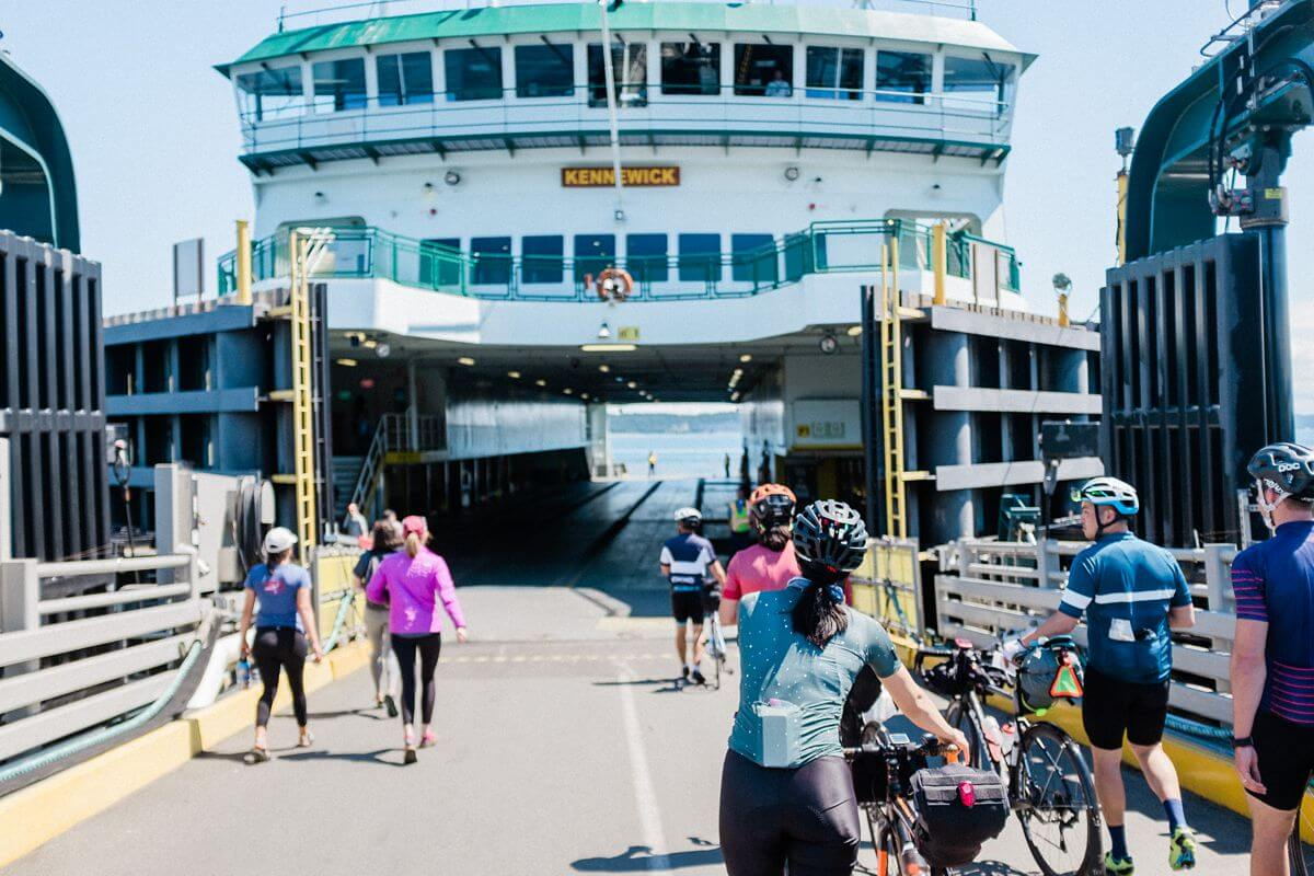 group of cyclists walking on ferry